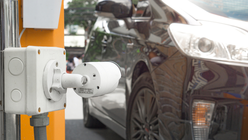 Security,Equipment,Concept,-,Cctv,Camera,Surveillance,On,Car,Parking